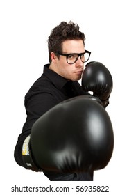 Guy in glasses wearing boxing gloves. Isolated on white