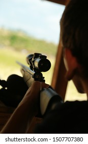 A guy with a gun is training in shooting at a shooting range.