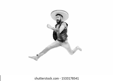 Guy happy cheerful face having fun dancing jumping. Life in motion. Man bearded cheerful guy wear sombrero mexican hat. Mexican energy. Mexican party concept. Celebrate traditional mexican holiday.