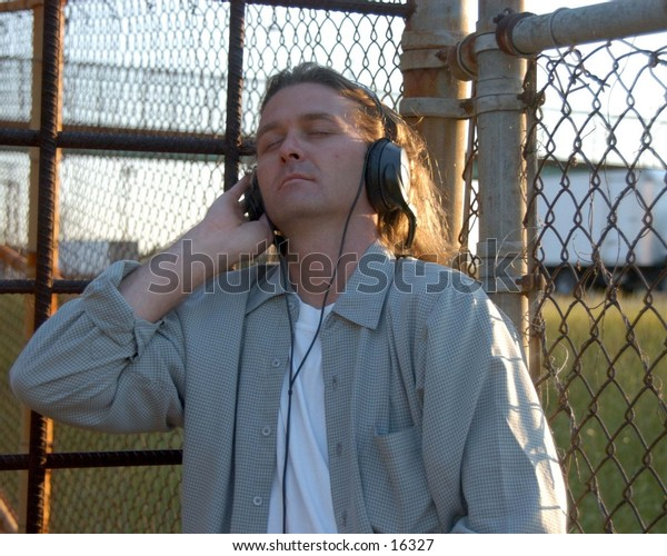Guy with headphones outside