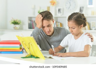 guy helps my sister to do homework