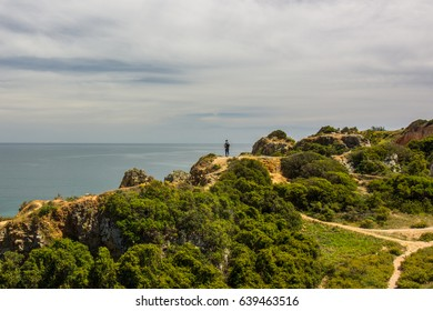 A guy hiking around the Lagos, Algarve coastline