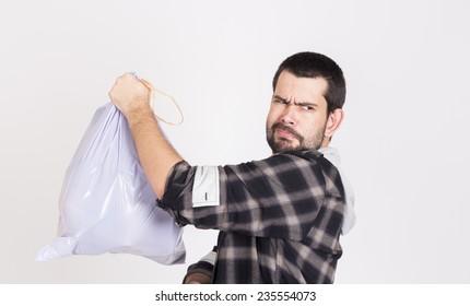 Guy hlding a bag trash