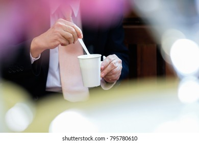 Guy with hot coffee in a glass paper of white paper