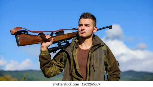 Guy hunting nature environment. Masculine hobby activity. Hunting season. Hunting weapon gun or rifle. Man hunter carry rifle nature background. Experience and practice lends success hunting.