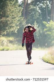 Guy jumping on skateboard