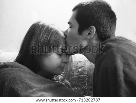 Black guy kissing white girl