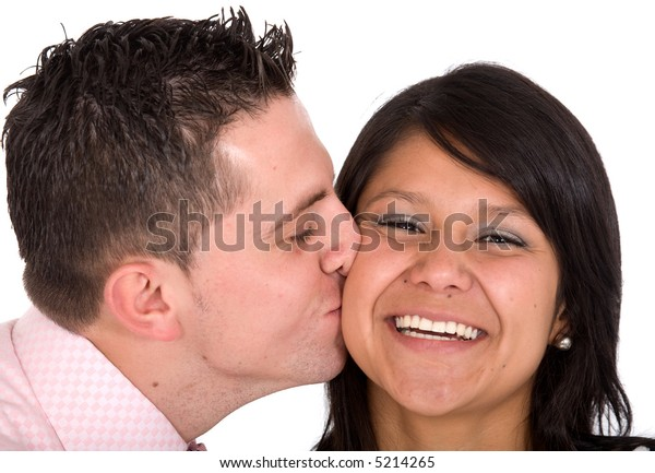 guy kissing his girlfriend on a cheek over a white background