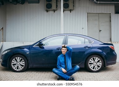 The guy leaning on his car