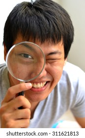 Guy look through magnifying glass