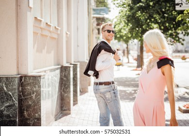 guy looking at a nice girl passing by...while walking at the street