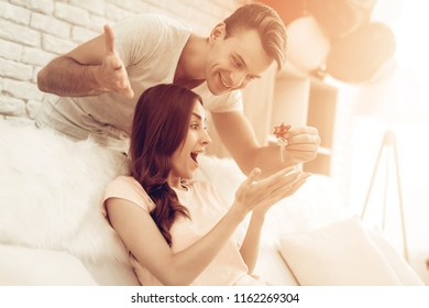 Guy Makes A Gift To Girlfriend On Valentine's Day. Love Each Other. Sweetheart's Romantic Moment Concept. Young And Handsome. Happy Relationship. Feelings Showing. Present Holding.