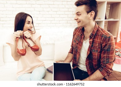 Guy Makes A Gift To Girlfriend On Valentine's Day. Love Each Other. Sweetheart's Romantic Holiday Concept. Young And Handsome. Happy Relationship. Feelings Showing. Present Opening.