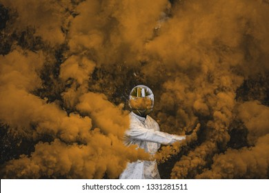 guy in mask standing in between orange smoke bombs