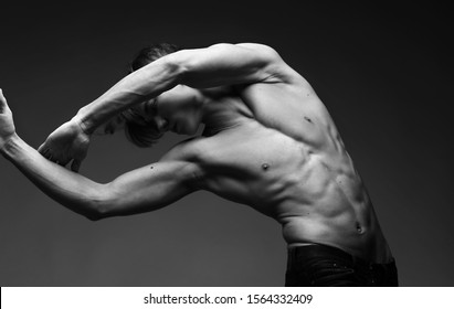 guy model with a bare torso bends beautifully in the photo and the structure of the body is embossed Look very sexy, ballet, gymnastics