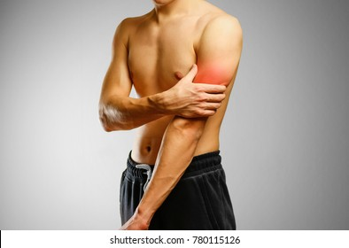 The guy with no shirt holding hand of a sick bicep. The pain in my arm. Sore biceps. The pain is marked in red.