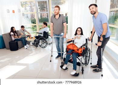 The guy on crutches, the guy on walkers for adults and the girl in a wheelchair. Disabled in the waiting room.