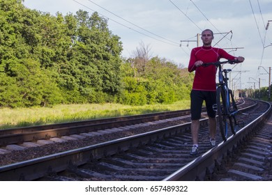 Guy on rails with a bicycle