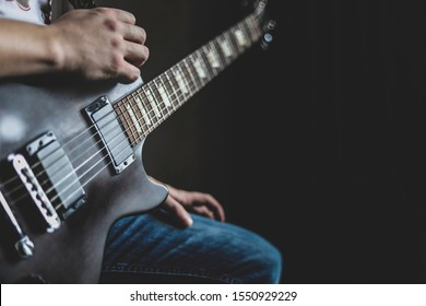 the guy playing the guitar