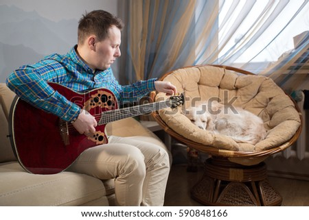 Guy Playing Guitar On Couch Chair Stock Photo Edit Now 590848166