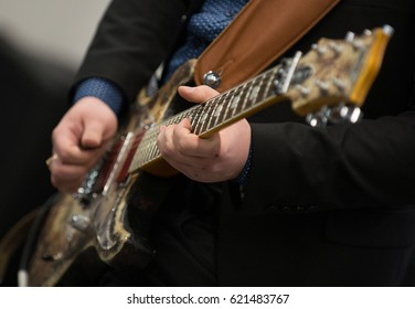 The guy plays the electric guitar