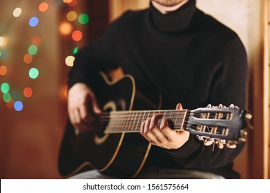 the guy plays the guitar. close-up of hands