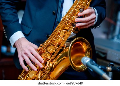 The guy plays the saxophone