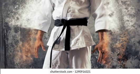 Guy poses in white kimono with black belt. Japanese judo banner – Image