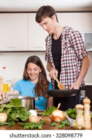 Guy and pretty girl  together cooking