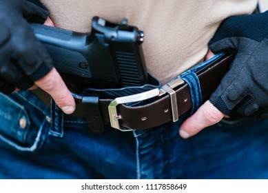 the guy puts the gun in the holster