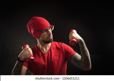 guy in a red hat and t-shirt posing on a black background