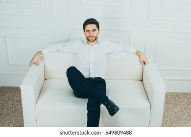 guy sits on the couch