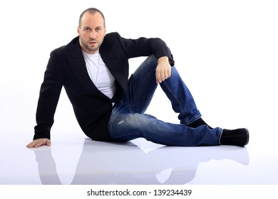 the guy sitting on the floor