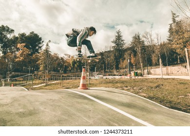 Guy skateboarding in a park. Concept of extreme urban sports.