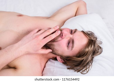 Guy sleepy morning nap. Pleasant awakening concept. Man unshaven handsome guy naked torso relaxing bed top view. Guy sexy macho lay white bedclothes. Man sleepy drowsy bearded face having rest.