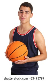 A guy smiling holding a basketball
