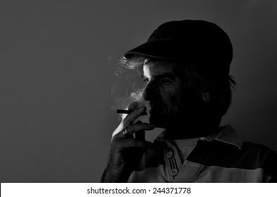 Guy Smoking a Cigar