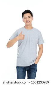 guy standing with arms folded, laughing.