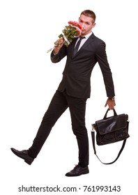 A guy steps with a bag and a bouquet of roses that sniffs on a white isolated background