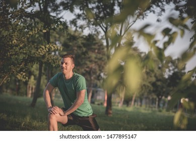 Guy stretching legs during warming-up for jogging