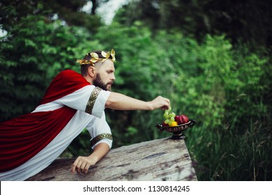 The guy in the style of ancient Rome. Eat grapes
