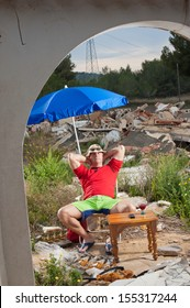 Guy sunbathing amidst  construction site rubble, a real estate crisis concept