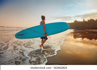 """guy surfing on a sunset """"instagram"""" style colors"""