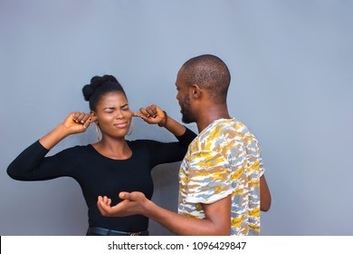 a guy is talking to a girl and she's not listening because she's not interested and she use her fingers to block her ears