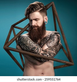 Guy with tattoo in wooden case