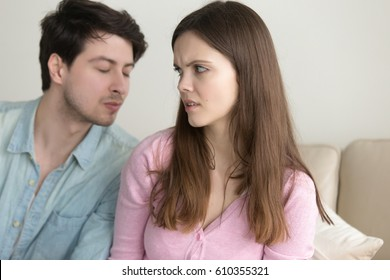 Guy tries to kiss woman, girl dislikes flirting and rejecting man, not interested, saying no, turning away, bad blind date, friend zone, problems in relationships, trying to make peace after quarrel