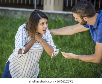 guy trying to help a girl while she's chocking