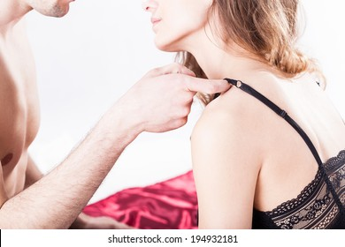 Guy undressing his lover on isolated background