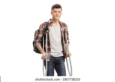 Guy walking with crutches isolated on white background
