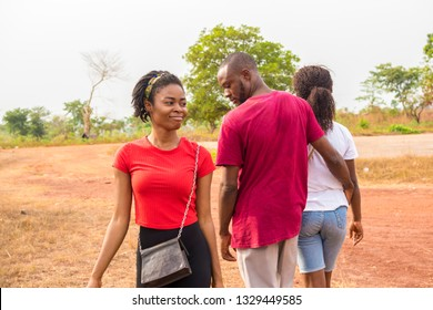 guy walking with his girlfriend admiring another girl walking past